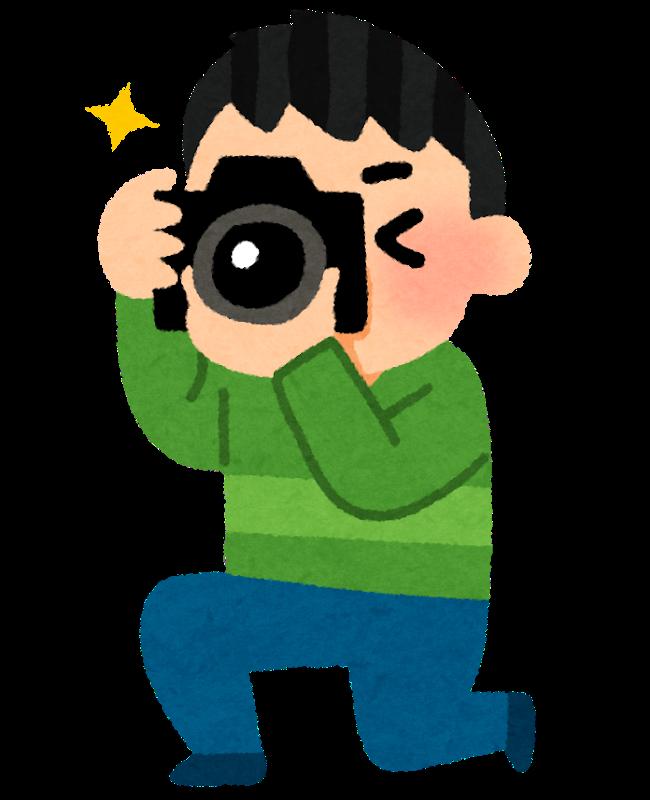 撮影している男性のイラスト