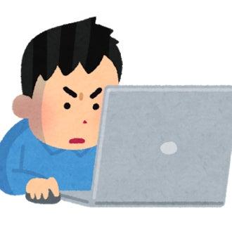 パソコンの作業に集中している男性のイラスト